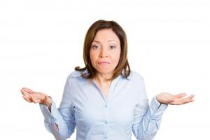 Uncertain woman shrugging shoulders