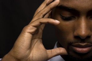 African American man is thinking intensely